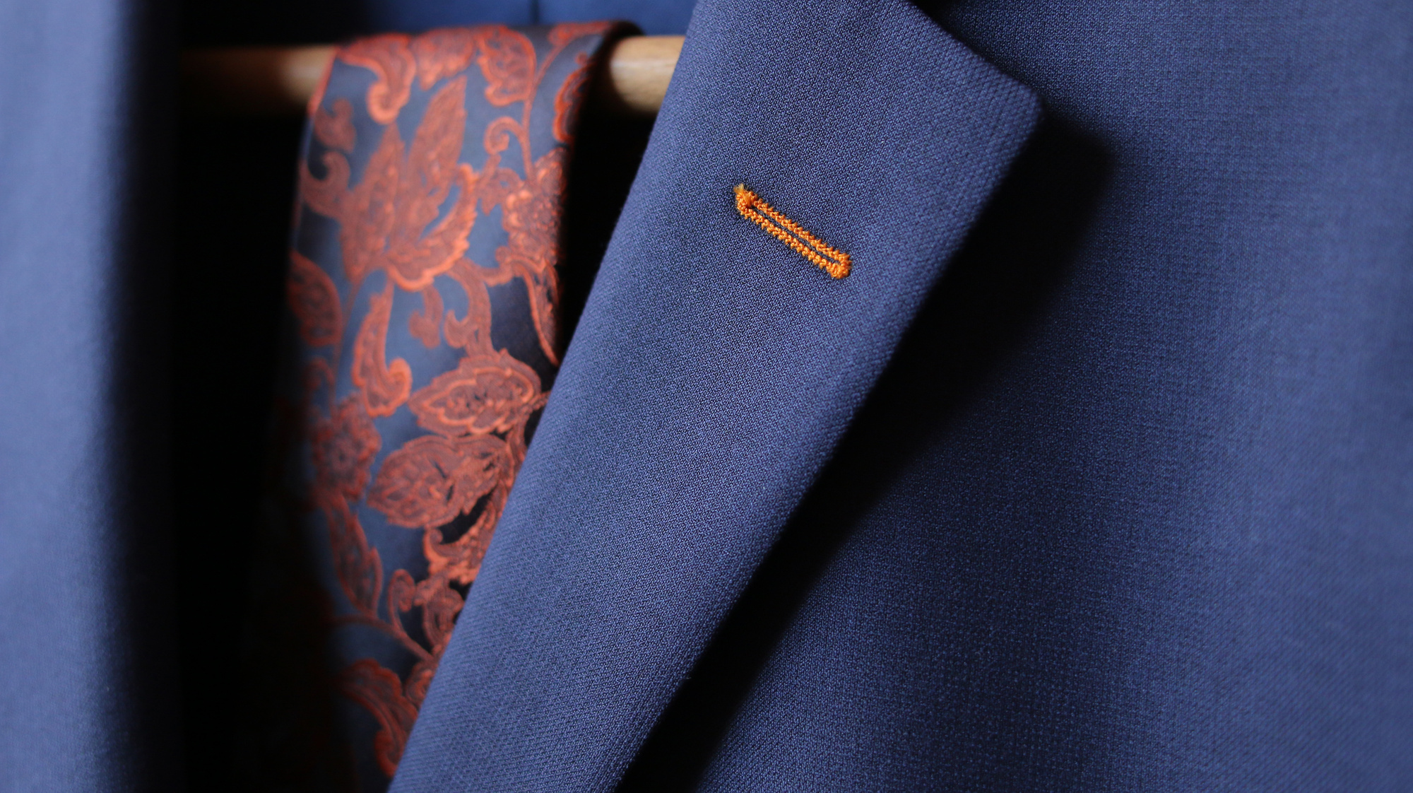 close-up of suit jacket lapel button hole fabric